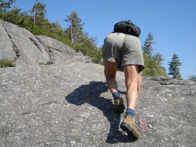 Lynn tackles large rock while hiking