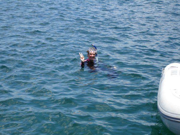 Lynn snorkels Norman Island, BVI.