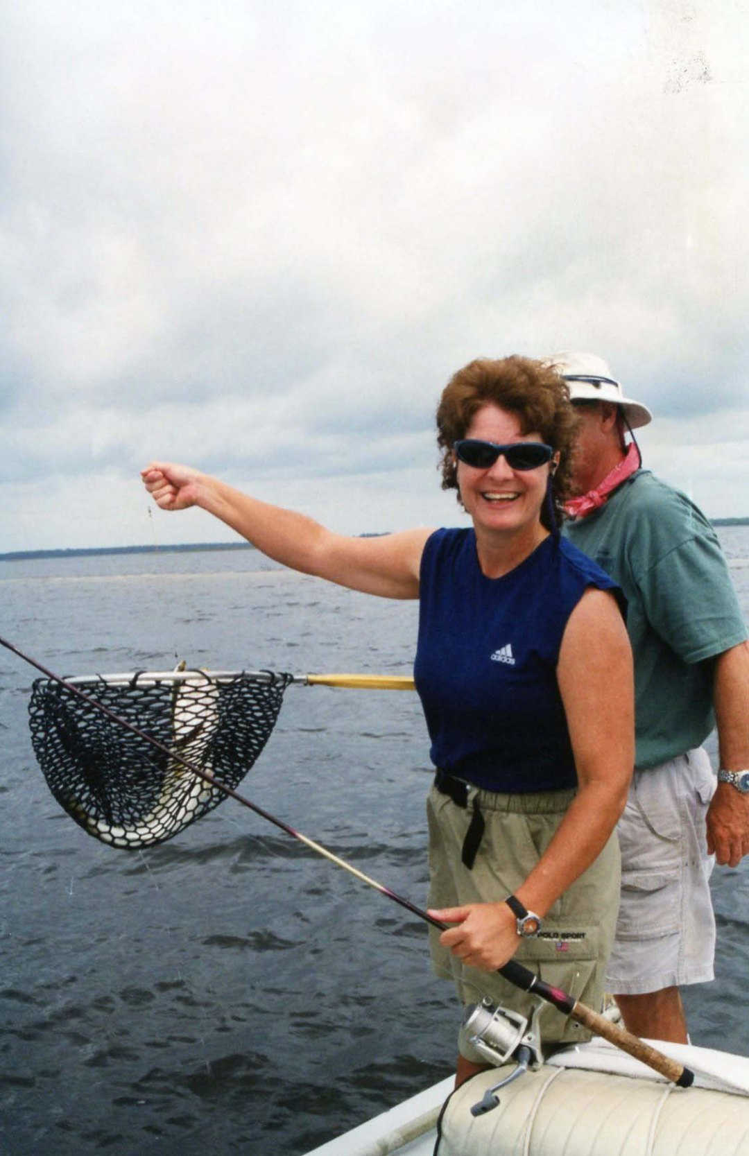 Lynn catches trout, 2002