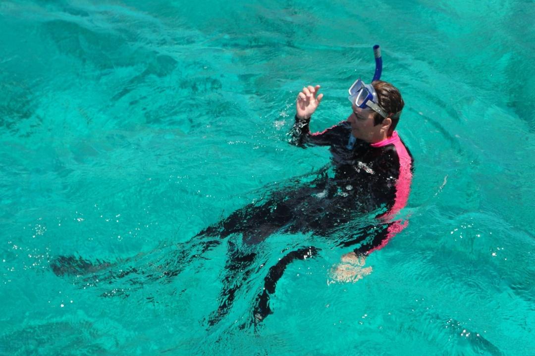 Lynn snorkels off West Caicos