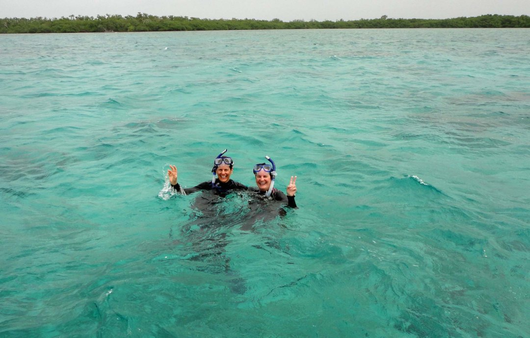 Snorkel girls off Turneffe Atoll, Belize.
