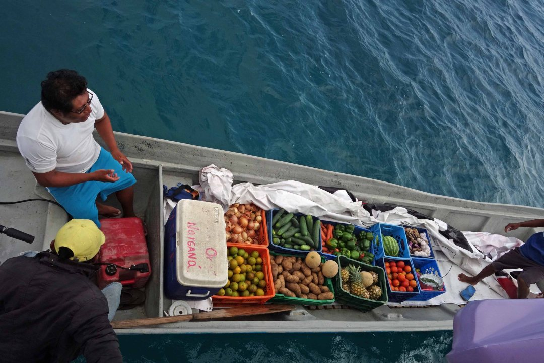 Fruit boat visit, Guna Yala islands, Panama, C.A.