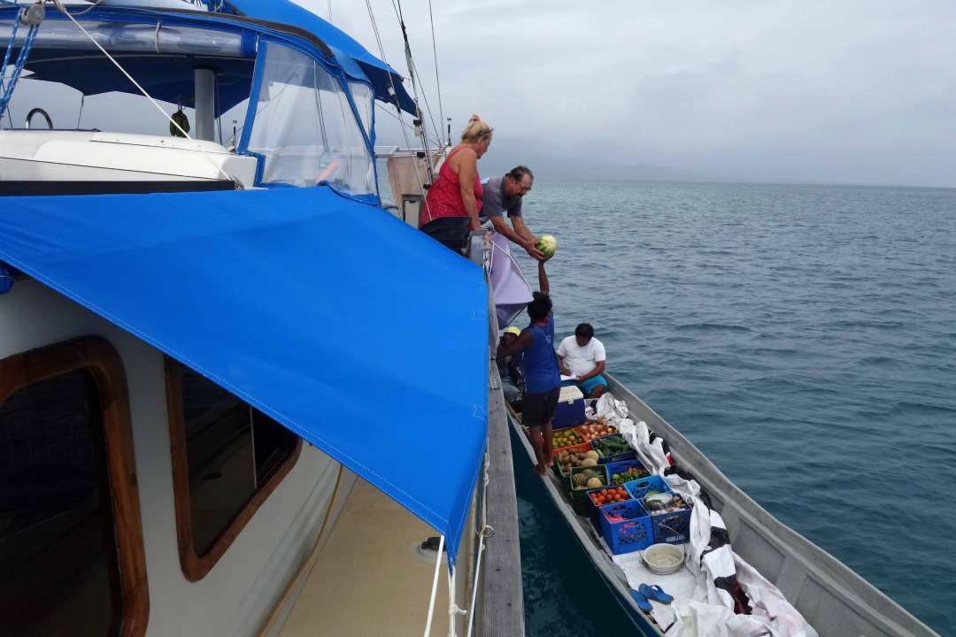 Fruit boat visit to Blue Sky yacht, Guna Yala islands, Panama, C.A.