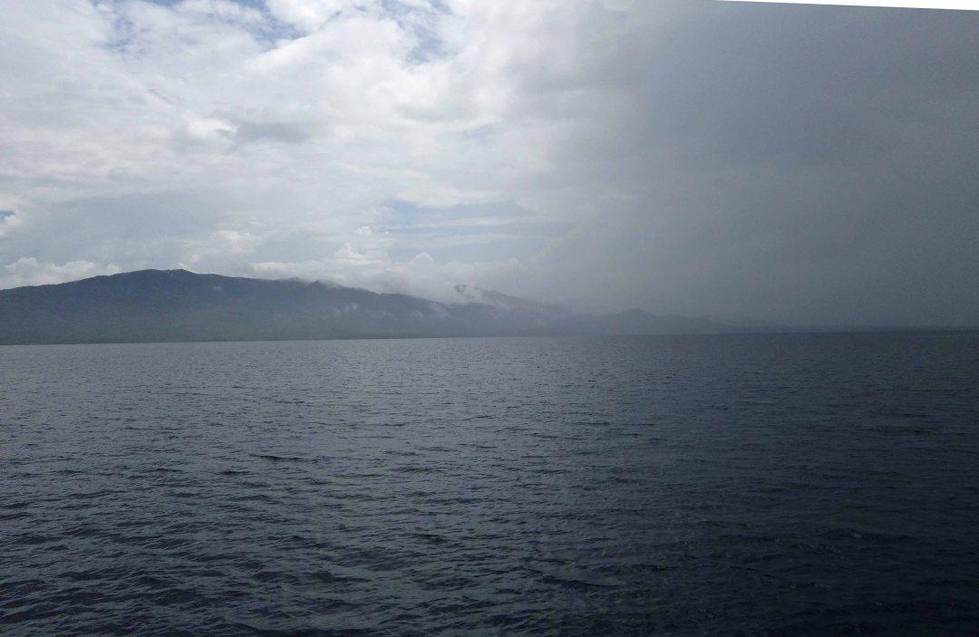 Rain over the Guna Yala islands, coast of Panama, C.A.